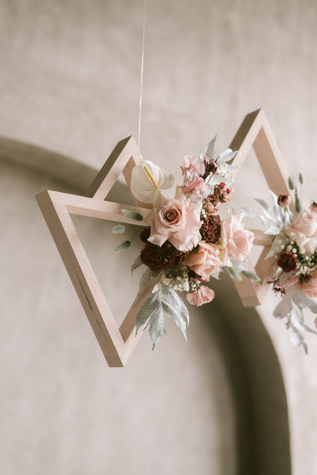 Triangular floral wedding installation floating in the air