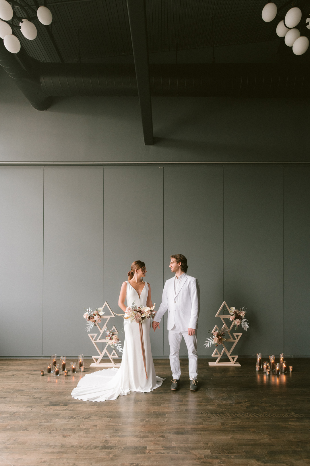 Wedding Couple looking at each other in a studio space