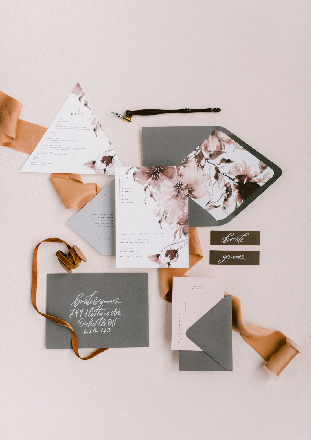 Flatlay of a Wedding stationary set with invitation card, menu and name tags