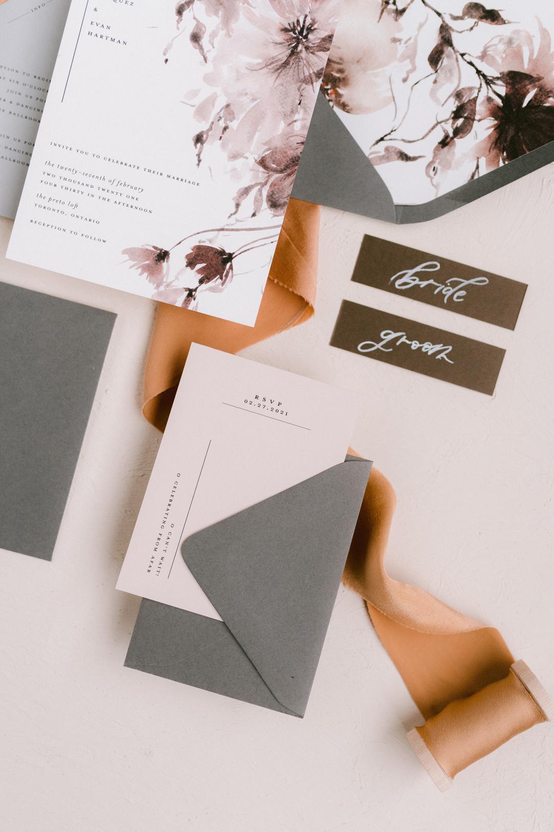 Beige wedding invitation cards with grey envelopes