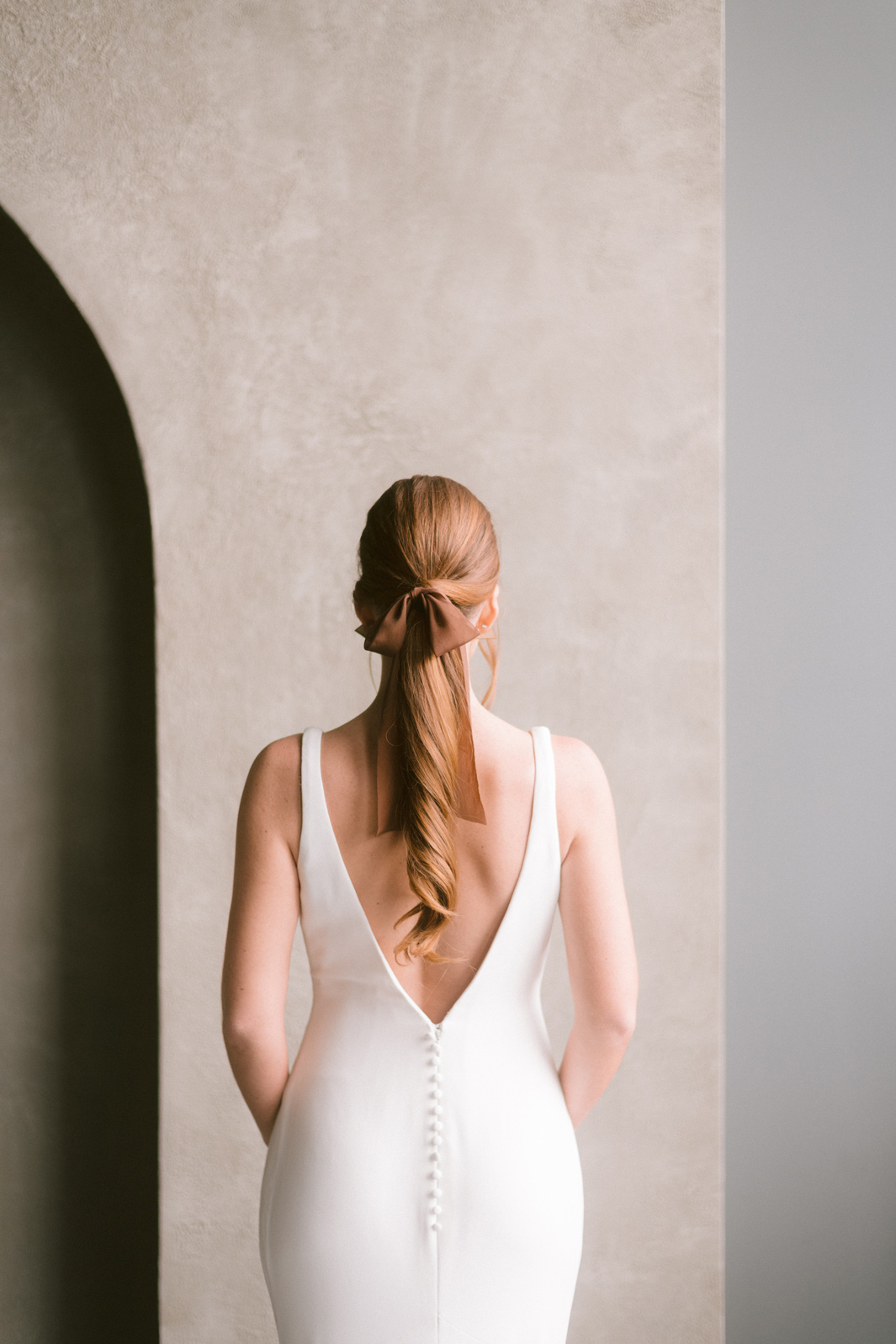 Bride in a white dress facing back