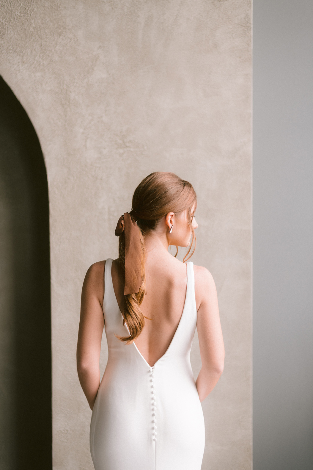Wedding Dress Back with model looking right