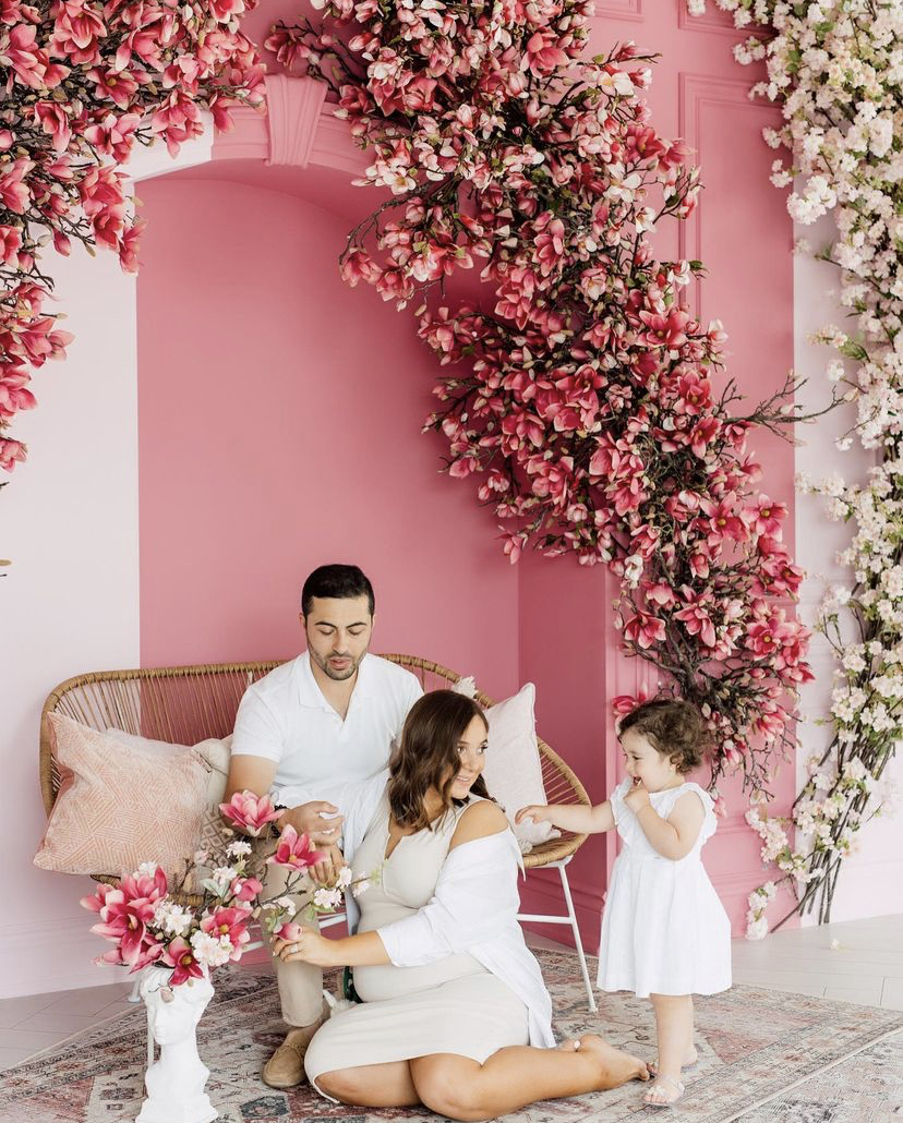 Family portrait in a floral summer setup