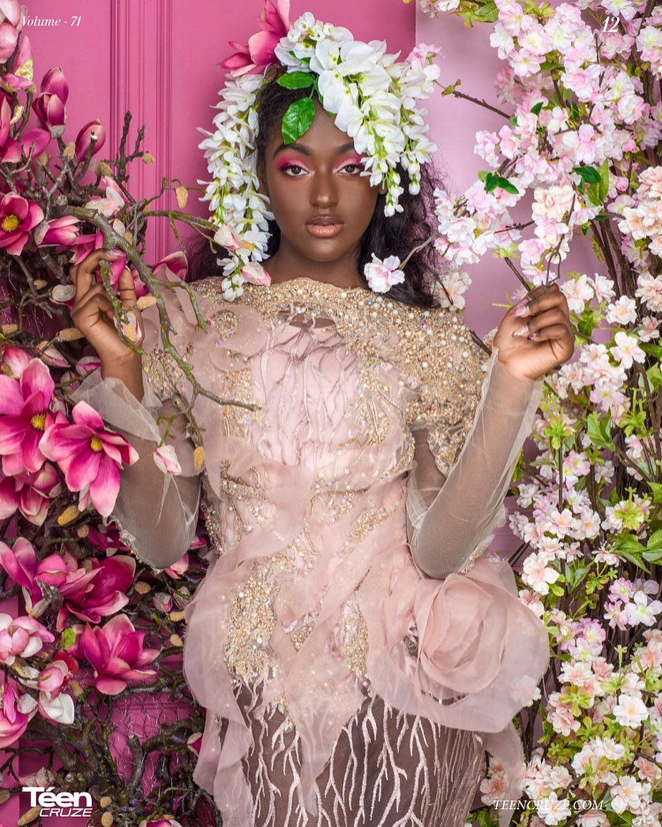 Editorial model posing in an extravagant dress covered in pink flowers